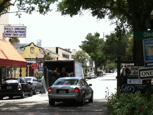 A truck being loaded at The Pear Tree on Brevard Avenue in Cocoa Village temporarily reduces the street to one lane of traffic. Dave Berman photo.