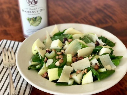 This hazelnut spinach salad with hazelnut oil dressing features fresh apples.