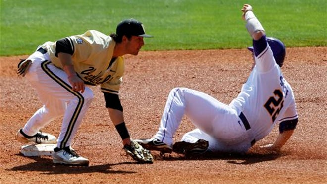 Vanderbilt's Dansby Swanson (7) gets the forced out as LSU's Kade Scivicque (22) slides into second during the second inning at the Southeastern Conference NCAA college baseball tournament on Wednesday, May 21, 2014, in Hoover, Ala. (AP Photo/Butch Dill)