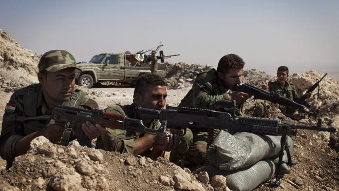 Iraqi Kurdish peshmerga fighters hold their position Tuesday east of Mosul in their ongoing battles with ISIS terrorists.