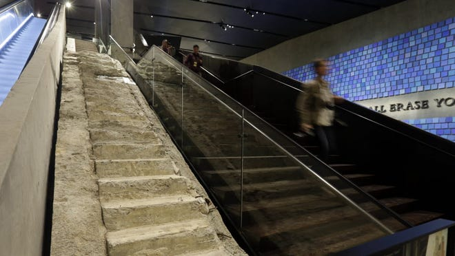 "The ""Survivor Stairs,"" left, from The World Trader Center, are displayed at the National Sept. 11 Memorial Museum."