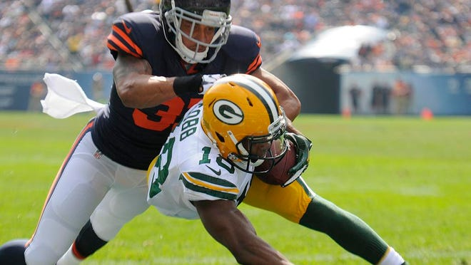 Green Bay Packers receiver Randall Cobb makes a touchdown catch against Chicago Bears cornerback Isaiah Frey during the second quarter of Sunday's game in Chicago.