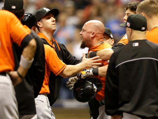 Casey McGehee of the Miami Marlins yells at Mike Fiers of the Milwaukee Brewers after he hit two batters with pitches at Miller Park on September 11, 2014 in Milwaukee, Wisconsin.