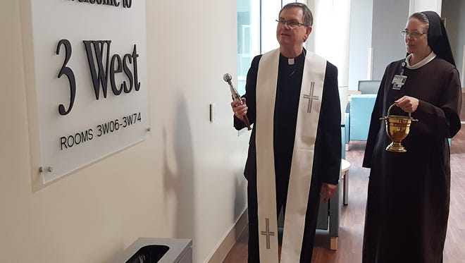 Bishop Timothy Doherty of the Diocese of Lafayette-in-Indiana blesses the new West Tower at Franciscan Health Lafayette East on April 9, 2018. He is assisted by Sister Petra Nielsen, OSF, vice president of administrative services for Franciscan Health.