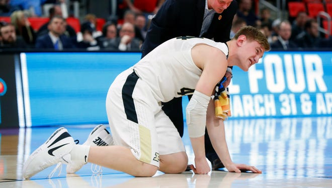 Purdue center Isaac Haas gets up off the court after fracturing his elbow Friday.
