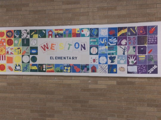 Weston Elementary School fifth-graders worked with their art teacher to create a mural for the school.