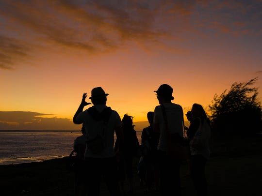 Visitors toast to the first sunset of 2016 during the