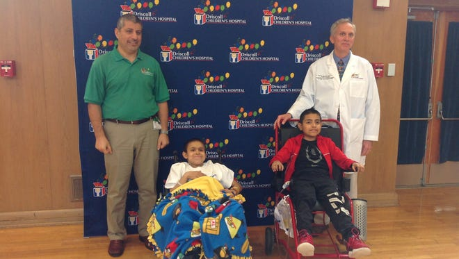 Izrel Saldivar (left) and Alejandro Gomez (right) are the 100th and 101st recipients of kidneys in the Driscoll Children's Hospital renal transplant program.