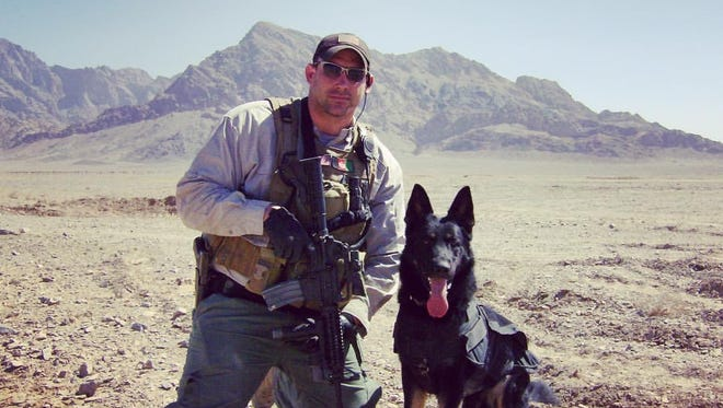 Dan Hughes is shown with his working dog K-9 Adak out side of Farah, Afghanistan in 2008. K-9 Adak worked as an explosive detection dog for private contractors that supported the U.S. State Department and Army in Iraq and Afghanistan.