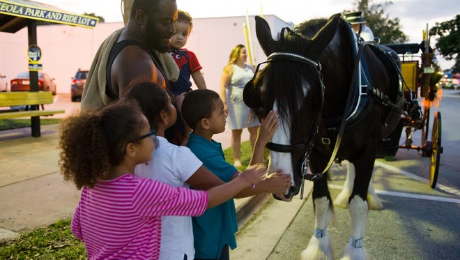 Children enjoy meeting the horses from the horse-drawn carriage rides in downtown Stuart.  If you don't have kids to entertain, a carriage ride also is a fun way to show off Stuart to out of town guests.