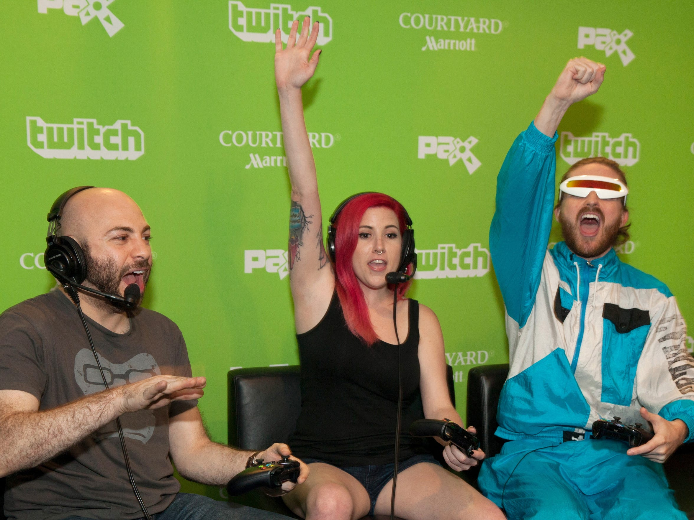 Avid gamers play video games during a Twitch live stream