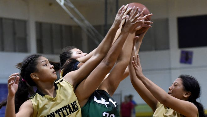 The John F. Kennedy Islanders' played the Tiyan Titans in an Independent Interscholastic Athletic Association of Guam Girls' Basketball League match at George Washington High School on Dec. 1. It was a big year for Tiyan High athletics.