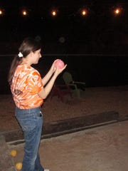 Yvonne Rogers prepares to throw a bocce ball at Hops and Hollers. (Ben Pounds/special to Go Knoxville)