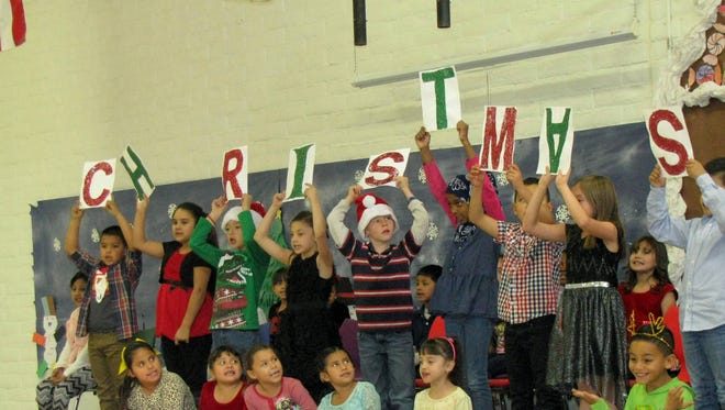 Bell Elementary School students, kindergarten through second grade, entertained family, faculty and friends during the annual Christmas assembly on Tuesday, Dec. 21, in the school's gymnasium. The students sang songs with choreographed movements and gestures that captivated the audience and drew loud applause. At the conclusion of the program, the students were greeted by a surprise visitor from the North Pole. He was a jolly ol' soul in a red suit. Families were also treated to cookies and refreshments. Deming Public Schools are officially on break and will return to its regular schedule on Jan. 9, 2017.