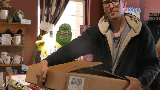 Scott Andersen delivers his Kansas Earth and Sky Candles to Heart of Kansas Mercantile in Great Bend.