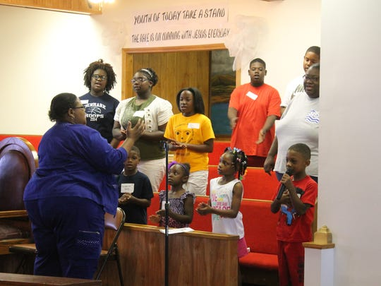 The Blairs Chapel CME Church Youth Choir leads students and parents in a devotional song during the Back 2 School Bash on Saturday at Blairs Chapel CME Church in Jackson.
