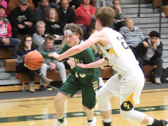 Howell's Johnny Shields tries to drive past South Lyon's
