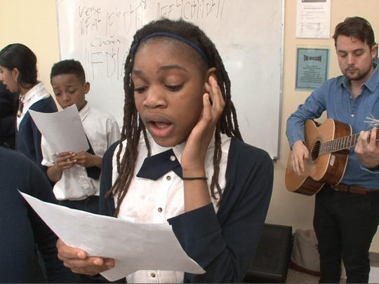 Dourna Moise, 11, sings with other Hope Academy of