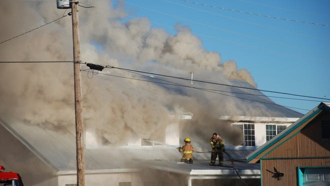 Firefighters from four departments battled a blaze Friday in a Carrizozo house. Nobody was inside, and there were no injuries.