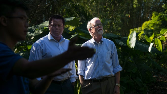 ECHO president and CEO David Erickson, right and Michael Chatman of the Cape Coral Community Foundation tour the tropical area of the farm in North Fort Myers. The Cape Coral Community Foundation secured a $25,000 grant for ECHO to help them prepare for future hurricanes.