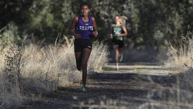 Greg Barnette/Record Searchlight Shasta High freshman Hana Hall cruises to a win in the EA-SRL Center Meet Wednesday at Foothill, finishing the 5,000-meter course in 20 minutes, 19 seconds.