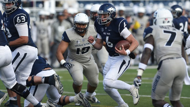 Nevada's Ty Gangi runs while taking on Utah State during their game Saturday. It was Gangi's 6-yard touchdown run with 5 seconds left that gave Nevada the win.