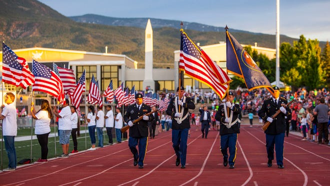 The color guard carries the American flag around the track during the opening ceremonies of the Utah Summer Games, Thursday, June 9, 2016.