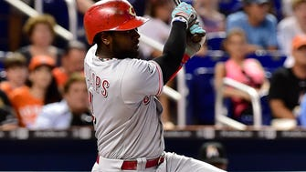 Cincinnati Reds second baseman Brandon Phillips (4) connects for a two-run double during the fourth inning against the Miami Marlins at Marlins Park.