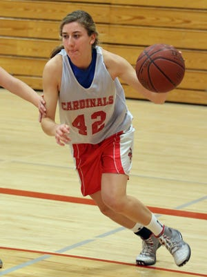 Newman Catholic's Caitlin Deaton drives to the hoop during practice Monday at the school.