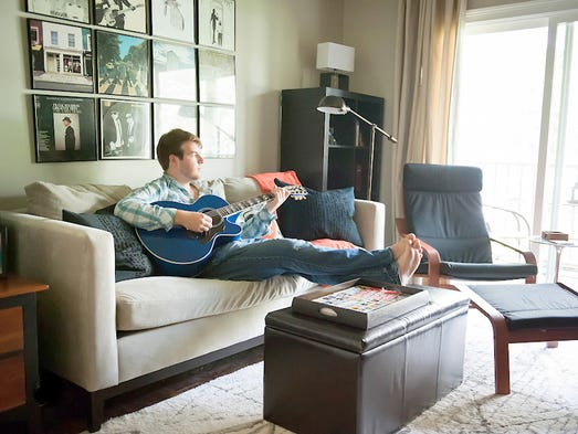 Young Nashville recording artist Sheldon Clark recently purchased a 650-square-foot condo near Hillsboro Village and Belmont. He needed a living room that would be multifunctional and stylish, a place where he could practice his music, watch television, entertain friends, eat his meals and work on the computer.