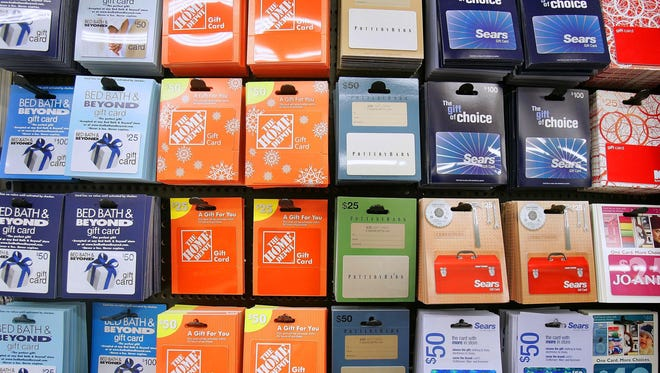 A variety of retail gift cards are seen on a kiosk at a store in Santa Clara, Calif.