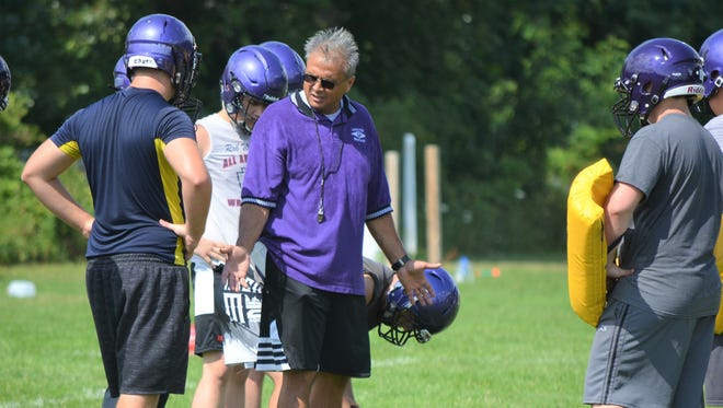 New Lakeview coach Jerry Diorio talks with players during camp earlier this summer.