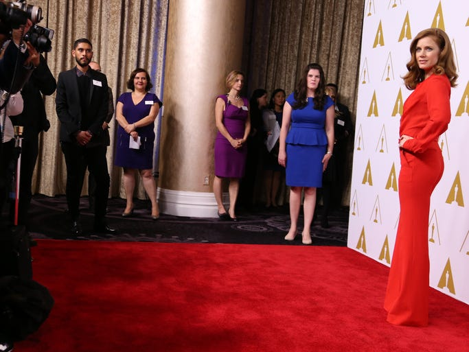 More than 150 Oscar honorees gathered for the 86th Oscar nominees luncheon on Feb. 10, 2014, in Beverly Hills. Amy Adams is striking in red on the Oscar luncheon red carpet.