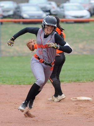 Waverly's Kalicia Doles rounds second base and heads for third during a 12-2 win over Portsmouth West on April 9, 2018 at Waverly High School. Doles will continue her academic and athletic careers at the University of Rio Grande next spring.