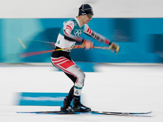 Lukas Klapfer, of Austria, competes during the 10km cross-country skiing portion of the nordic combined event at the 2018 Winter Olympics in Pyeongchang, South Korea, Wednesday, Feb. 14, 2018. (AP Photo/Dmitri Lovetsky)
