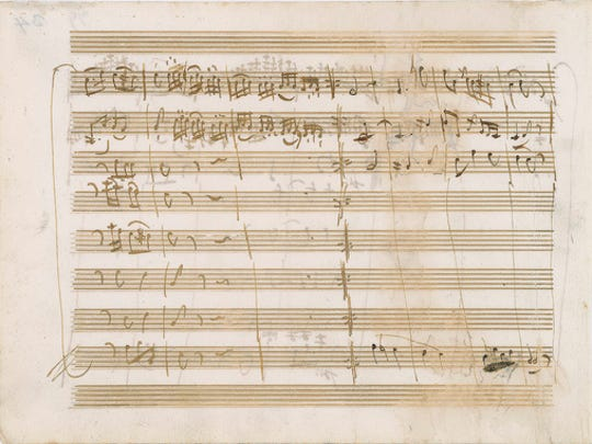 "This undated photo released by RR Auction shows one page of a handwritten musical score by Wolfgang Amadeus Mozart for the third movement, ""Allegro,"" of his Serenade in D Major, circa 1773. The manuscript, written on both sides of a single sheet, is set to be auctioned Wednesday, March 8, 2017, by the Boston-based auction firm."
