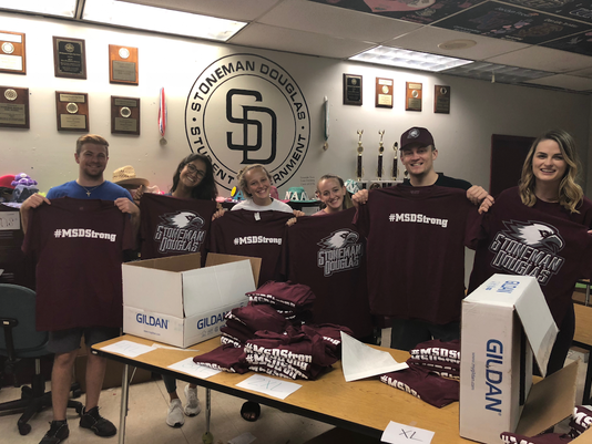 Marjory Stoneman Douglas students holding up their t-shirts