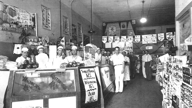 The Court House Meat Market in 1945. On the far left behind the counter is Fred Gittner, with the author's father-in-law, Bob Strang, next to him. Louie Gittner is on the right in dark slacks in the back of the market.