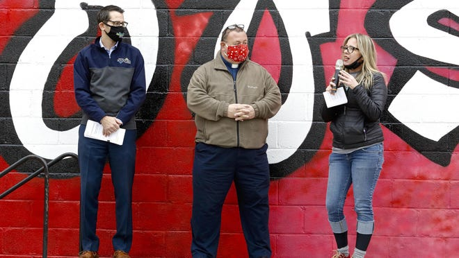 Rockford Mayor Tom McNamara, left, Salem Lutheran Church Pastor Bill Dahlberg and Dee Lacny, executive director of Rock House Kids, speak Saturday during the capital campaign kickoff and mural dedication outside Rock House Kids in Rockford.