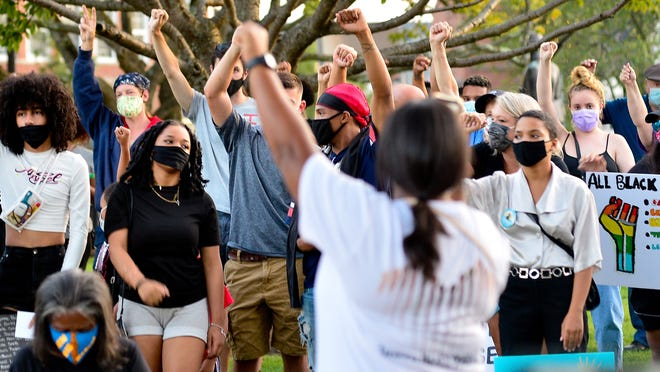 Supportes of Black Lives Matter show support during Friday nights protest held at the Taunton Green August 28,2020.Mike Borden/for The Taunton Gazette