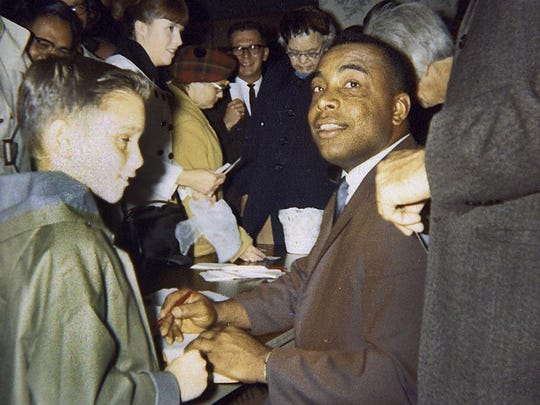 Eight-year-old Phil Bolsta (left) gets an autograph from Minnesota Twins catcher Earl Battey in 1965.