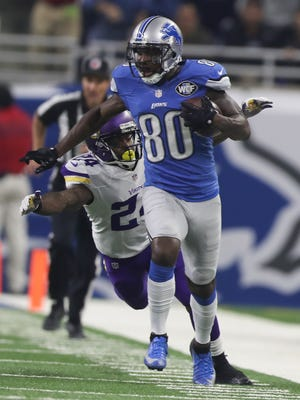 Lions receiver Anquan Boldin makes a catch against Minnesota Vikings cornerback Captain Munnerlyn in the second half Thursday, Nov. 24, 2016 at Ford Field in Detroit.