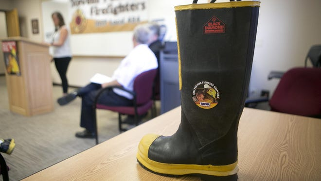 """A boot used for the Muscular Dystrophy Association """"Fill the Boot"""" Campaign during a kickoff event at the Stevens Point Fire Department, Wednesday, July 7, 2015."""