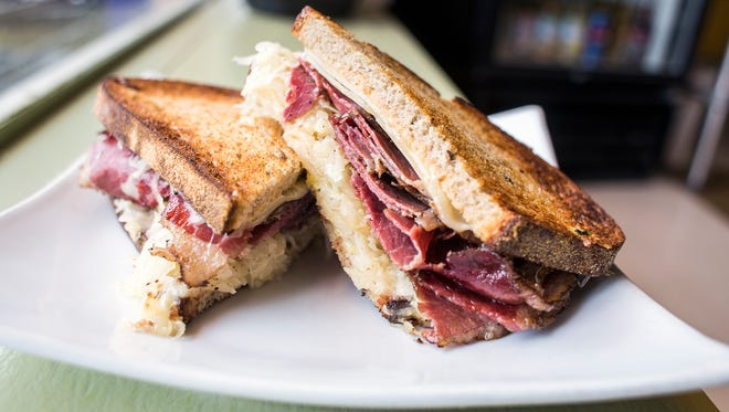 Nona Mia Market & Deli's Reuben features house-cured pastrami, sauerkraut, homemade Thousand Island dressing and Swiss cheese on Nona Mia rye bread.