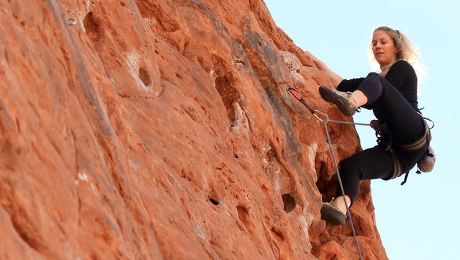 Malynda Madsen climbs the Chuckwalla Wall in the Red Cliffs Desert Reserve in northern St. George.