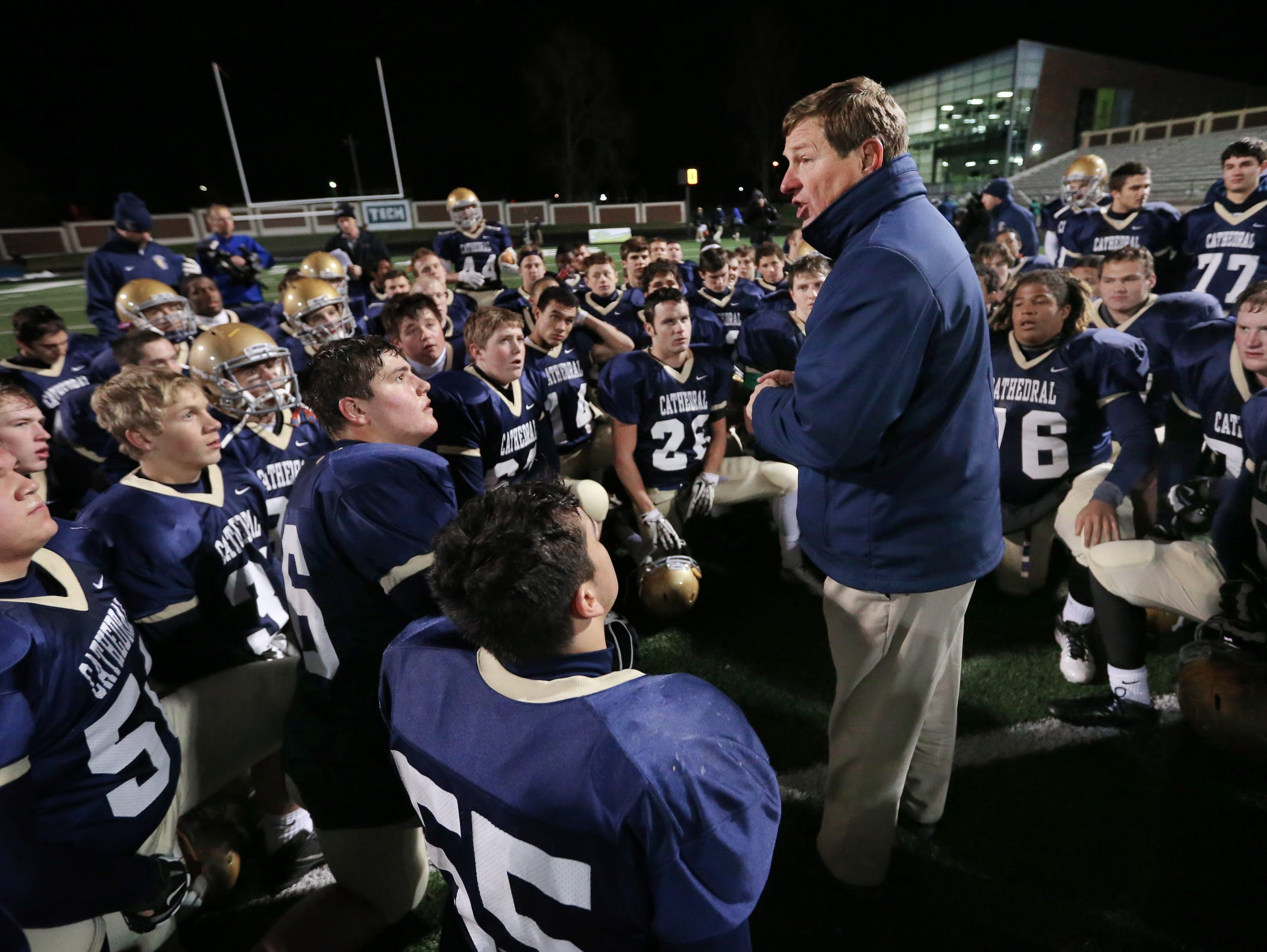 Cathedral head coach Rick Streiff congratulates his players after their IHSAA Semi state football win over Terre Haute North on Nov. 22, 2013 held at Arsenal Tech High School.