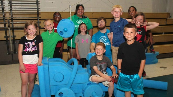 Boys and Girls Club of Otero County members show off their creation Friday. The new equipment was unvailed at the Boys and Girls Club.
