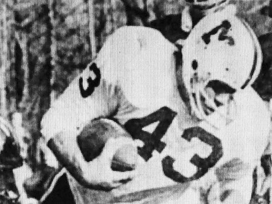 Matawan fullback Gary Weber pounds for yardage during the Huskies 7-0 win over Colonia in the 1975 NJSIAA Central Jersey Group IV final.