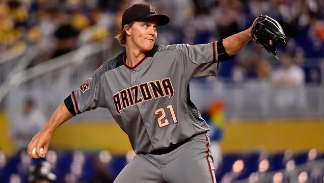 Jun 28, 2018; Miami, FL, USA; Arizona Diamondbacks starting pitcher Zack Greinke (21) delivers a pitch in the first inning against the Miami Marlins at Marlins Park. Mandatory Credit: Jasen Vinlove-USA TODAY Sports