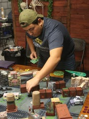 The tabletop games at Dungeon Games in Estero can get